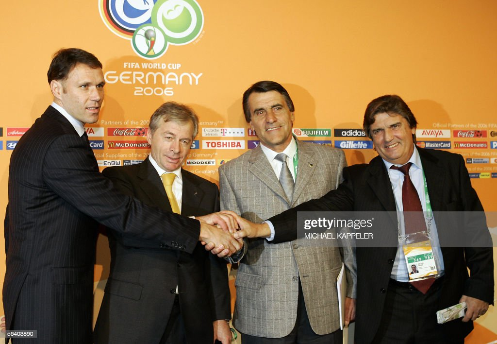 Group C coaches (From L to R) Netherland?s head coach Marco van Basten, Ukraine?s head coach Oleg Blokhin, Argentinian assistant coach Hugo Toccali and Ivory Coast head coach Henri Michel of France pose together after the final draw of the Fifa World Cup 2006 in Leipzig 09 December 2005. World Cup holders Brazil and the other 31 nations competing in next year's finals learned their first-round opponents when the draw was made in a star-studded ceremony.