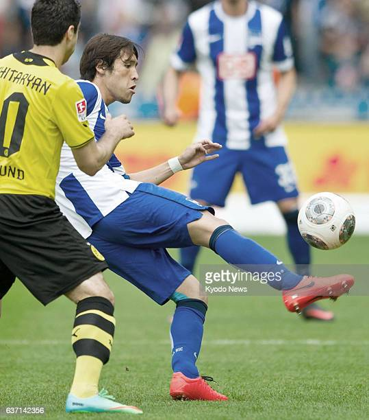 BERLIN Germany Hajime Hosogai of Hertha Berlin and Borussia Dortmund's Henrikh Mkhitaryan are seen in action in a Bundesliga match in Berlin on May...
