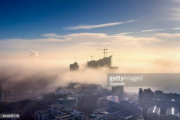 Germany, Hamburg, aerial view of the Elbphilharmonie and city in dense fog