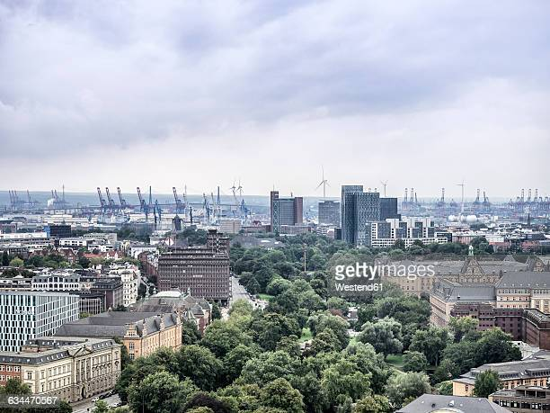 Germany, Hamburg, cityscape with Koehlbrand bridge and harbor cranes