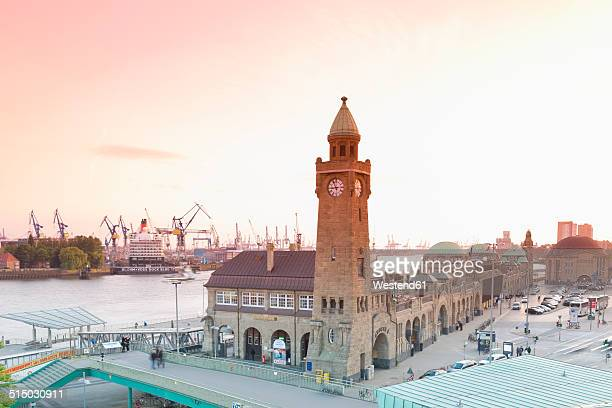 Germany, Hamburg, Clocktower at Landungsbruecken in the evening light