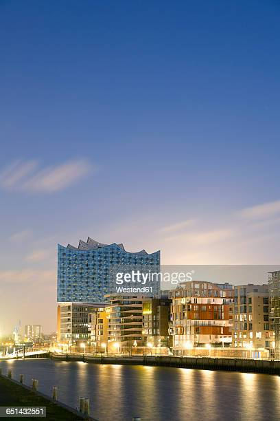 Germany, Hamburg, Hafencity, Grasbrook Harbour with Elbe Philharmonic Hall in the evening