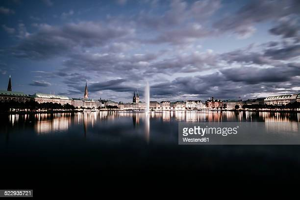 Germany, Hamburg, Inner Alster and Alster fountain at night