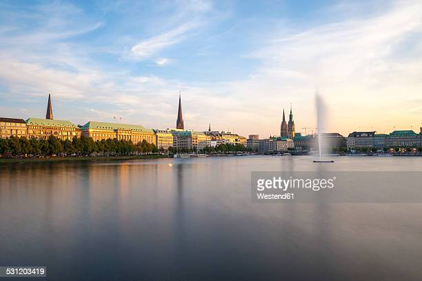 Germany, Hamburg, Inner Alster and Alster fountain in the evening light
