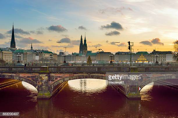 Germany, Hamburg, Lombard bridge on the Inner Alster Lake at sunset