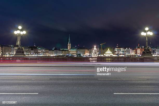 Germany, Hamburg, Lombardsbruecke crossing the Alster Lake at night