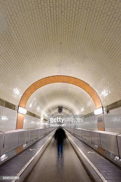 Germany, Hamburg, man walking in Old Elbe Tunnel
