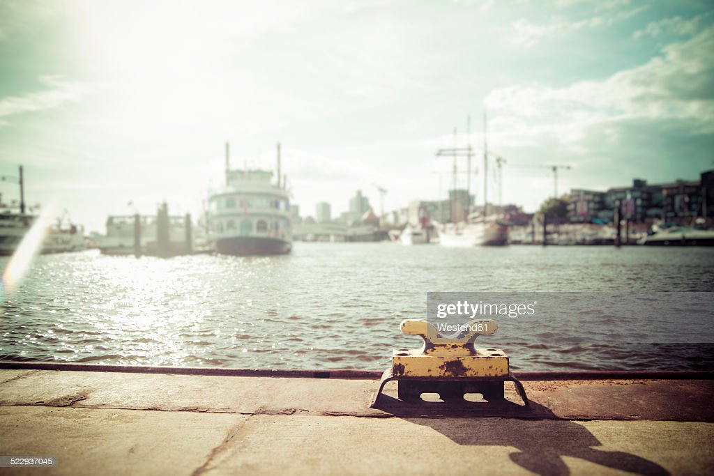 Germany, Hamburg, Port of Hamburg, Elbe river, Bollard against the sun