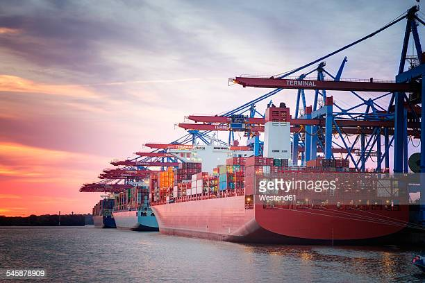 Germany, Hamburg, Port of Hamburg, Harbour, container ship in the evening