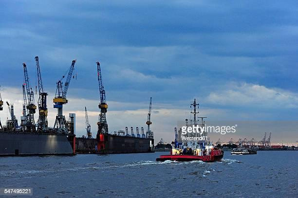Germany, Hamburg, River Elbe with tugboat