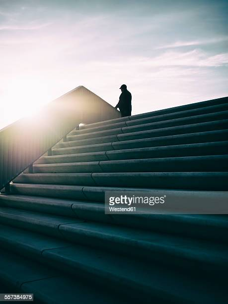 Germany, Hamburg, silhouette of a man at backlight