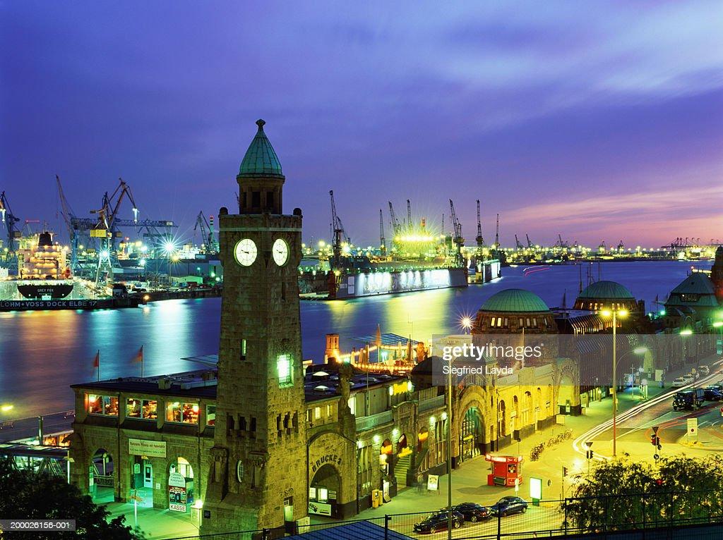 Germany, Hamburg, St. Pauli Landungsbrucken and harbour at dusk : Stock Photo