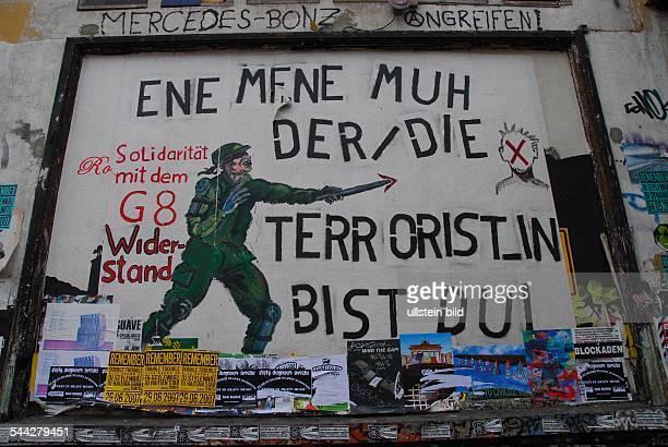 Germany Hamburg St Pauli Protestors pass a banner at Hamburg's culture centrum 'Rote Flora' against the upcoming G8 summit