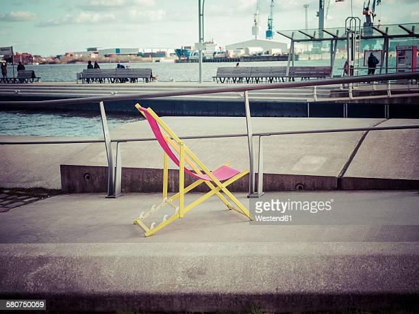 Germany, Hamburg, sun lounger at harbour