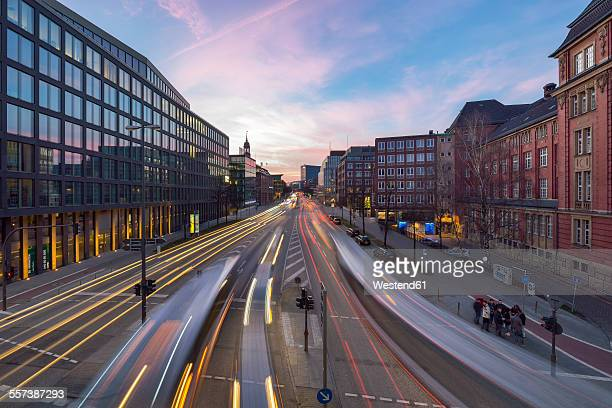 Germany, Hamburg, view to Willy-Brandt-Strasse with light trails at twilight