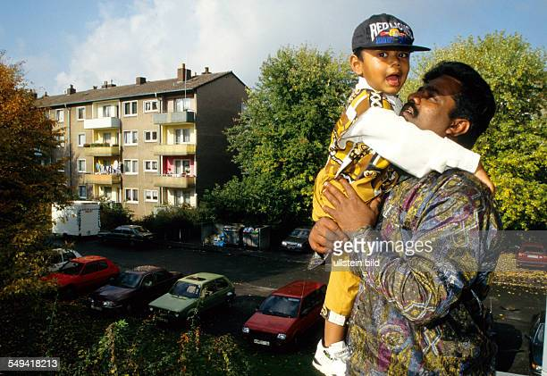 HinduTamils in Germany A Tamils family in their apartment father and son on their balkony