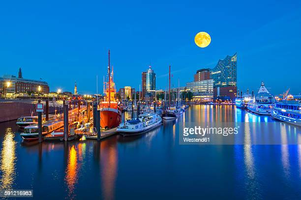 Germany, Harbour at full moon, Elbphilharmonie and Hanseatic Trade Center in background
