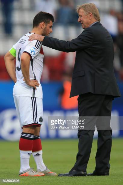 Germany Head Coach Horst Hrubesch consoles Germany's Kevin Volland after defeat