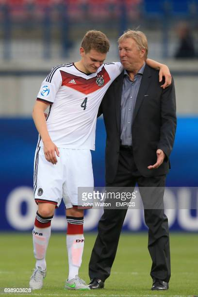 Germany Head Coach Horst Hrubesch consoles Germany's Matthias Ginter after defeat