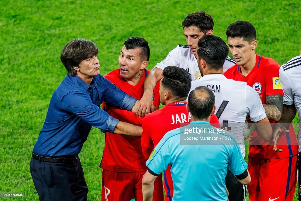 Germany Head Coach / Manager Joachim Loew clashes on the pitch with Gonzalo Jara of Chile during FIFA Confederations Cup Russia final match between Chile and Germany at Saint Petersburg Stadium on July 2, 2017 in Saint Petersburg, Russia.