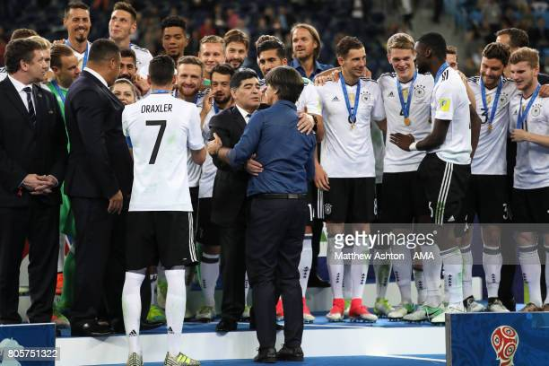 Germany Head Coach / Manager Joachim Low is congrayulated by Diego Maradona at the end of the FIFA Confederations Cup Russia 2017 Final match between...