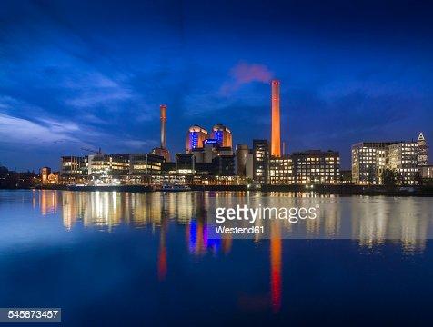 Germany, Hesse, Frankfurt, Gutleutviertel, Westhafen, Cogeneration plant in the evening