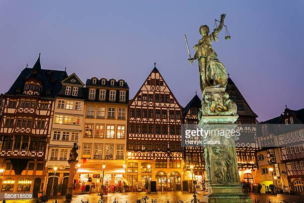 Germany, Hesse, Frankfurt, Romerberg Plaza, Statue on illuminated square