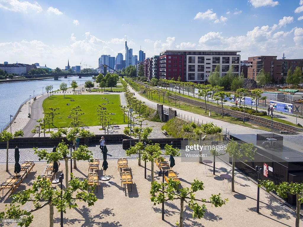 Germany, Hesse, Frankfurt, view to skyline with new park and beer garden in the foreground
