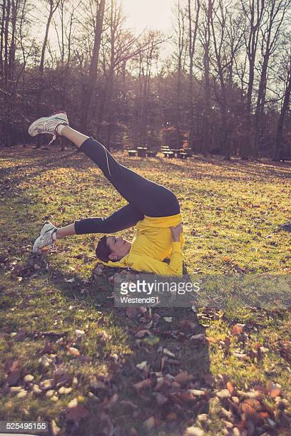 Germany, Hesse, Lampertheim, Woman doing sports in forest