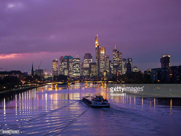 Germany, Hesse, View of Frankfurt am Main, Floesserbruecke and financial district at night