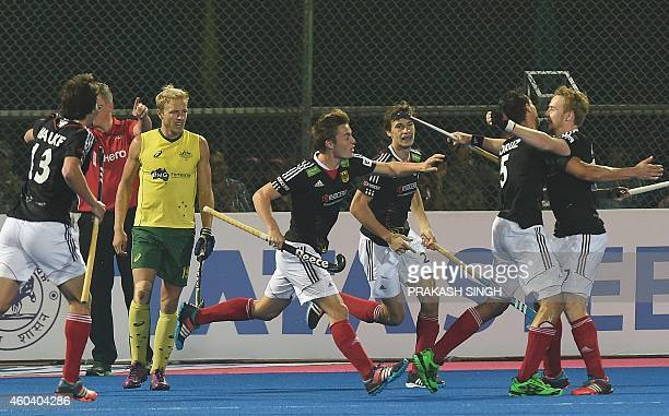Germany hockey players celebrate a goal against Australia during their Hero Hockey Champions Trophy 2014 semi final match at Kalinga Stadium in...