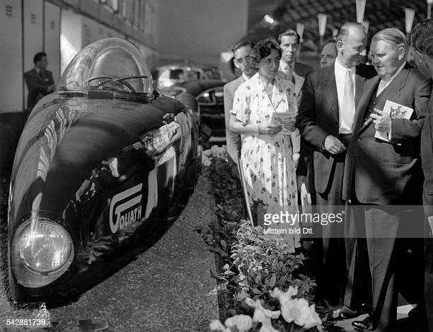 Germany International Motor Show Berlin 1951 to the right Federal Minister of economic affairs Ludwig Erhard looking at a Goliath threewheeler