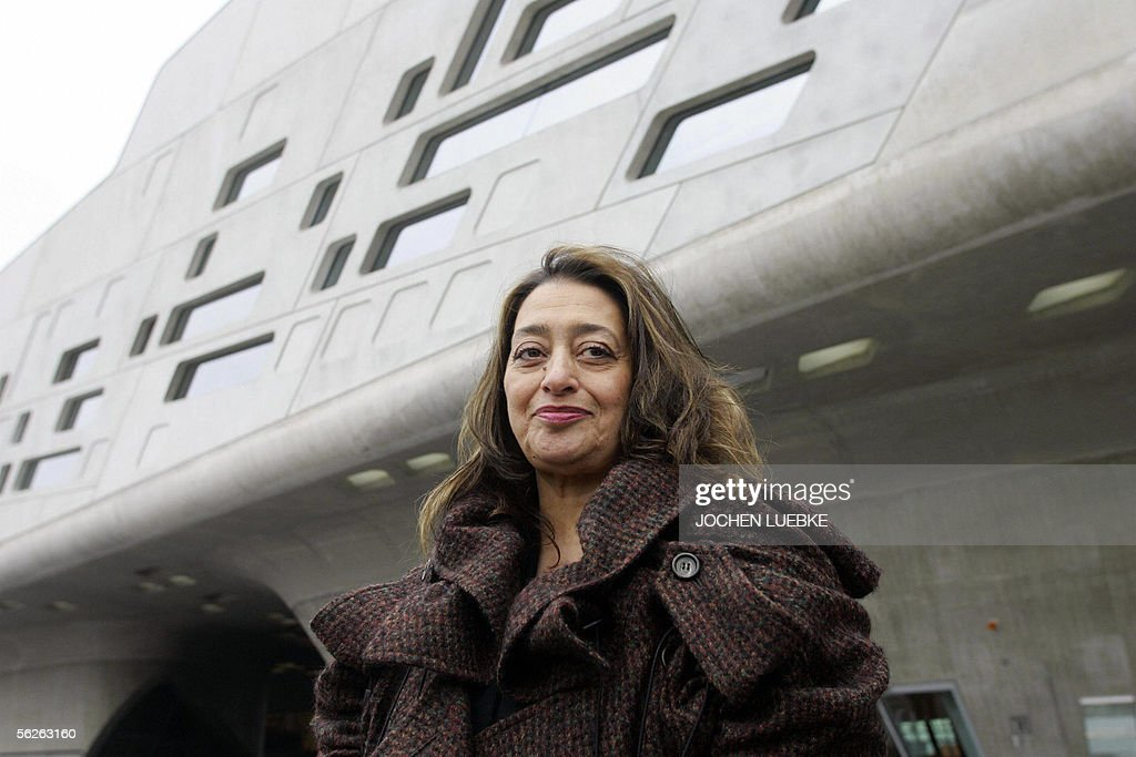 Iraqi-born London-based architect <a gi-track='captionPersonalityLinkClicked' href=/galleries/search?phrase=Zaha+Hadid&family=editorial&specificpeople=560782 ng-click='$event.stopPropagation()'>Zaha Hadid</a> poses in front of the building housing the 'Phaeno' Science Center and museum in Wolfsburg 23 November 2005. The building, which has 9.000 square meters of exhibition space, will house a science center where people will be able to 'experience' scientific experiments. The center, built at a cost of EUR 80 million, will be inaugurated 25 November 2005.