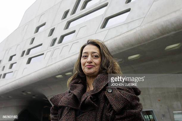 Iraqiborn Londonbased architect Zaha Hadid poses in front of the building housing the 'Phaeno' Science Center and museum in Wolfsburg 23 November...