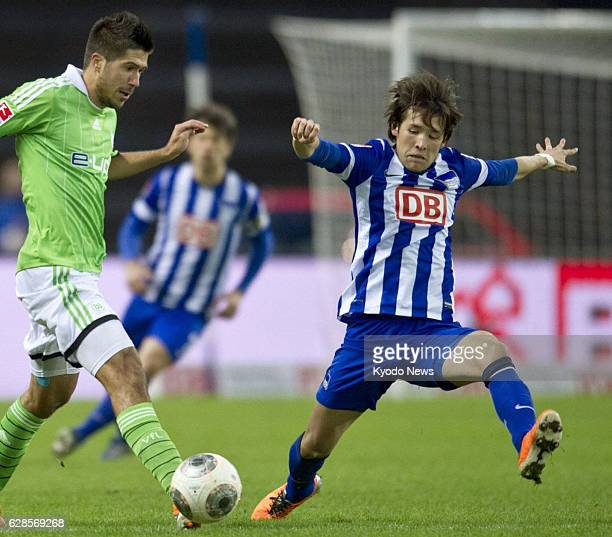 BERLIN Germany Japan midfielder Hajime Hosogai of Hertha Berlin competes for the ball during a German first division Bundesliga soccer match against...