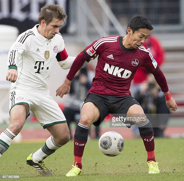 NUREMBERG Germany Japan midfielder Hiroshi Kiyotake of Nuremberg appears in the starting lineup and competes for the ball during the first half of...