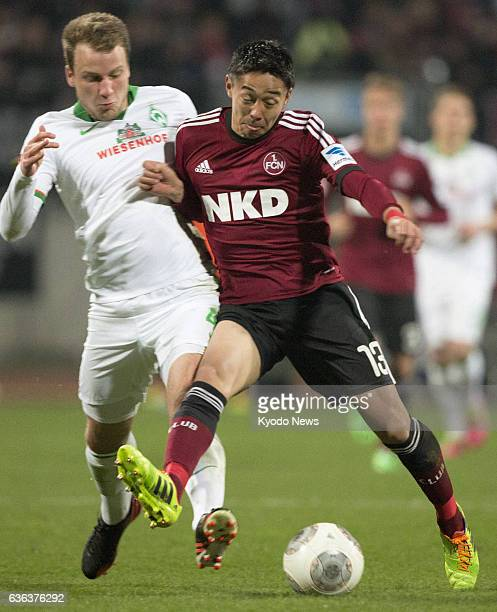 NUREMBERG Germany Japanese footballer Hiroshi Kiyotake of Nuremberg and Werder Bremen's Philipp Bargfrede fight for the ball in a Bundesliga clash in...