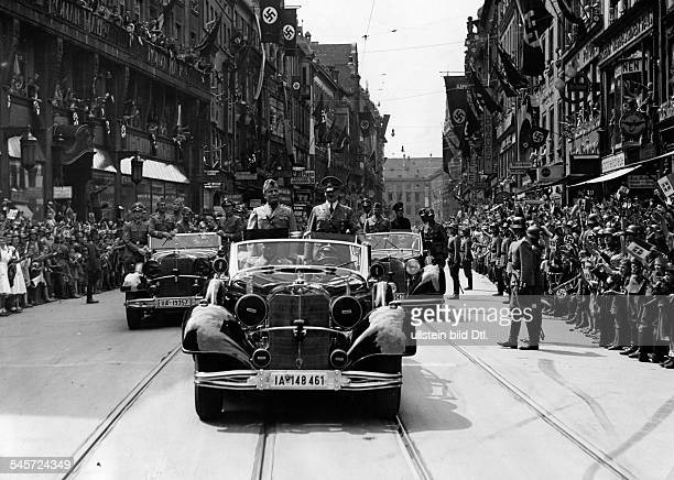 Germany Kingdom Bavaria Munich Foreign Affairs Germany/Italy Adolf Hitler and Benito Mussolini in the car on the way to the PrinzCarlPalais in front...