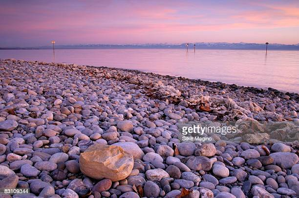 Germany, Lake Constance, Pebbles on lakeshore at dusk