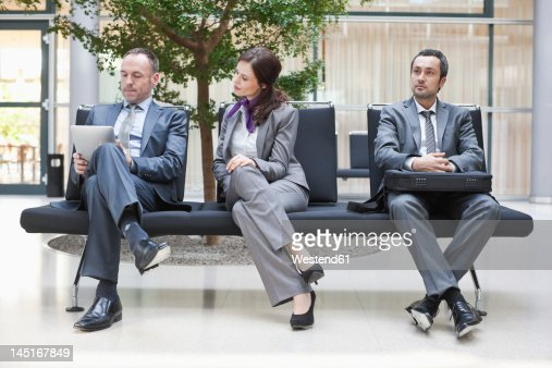 Germany, Leipzig, Business people sitting on bench