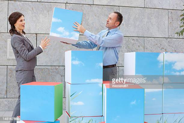 Germany, Leipzig, Business people with cubes