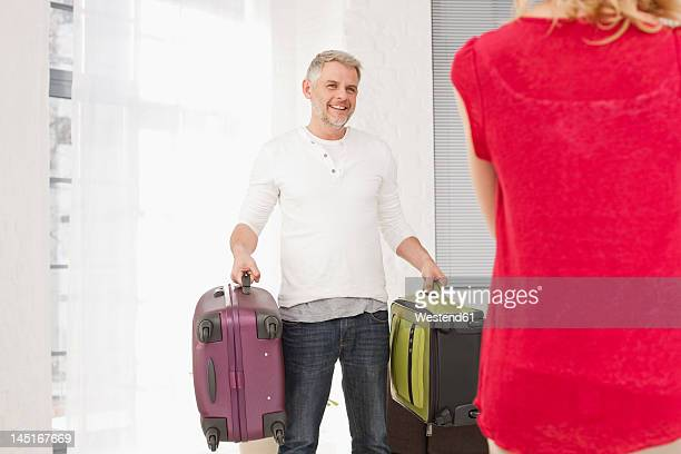 Germany, Leipzig, Couple carrying suitcase for vacation