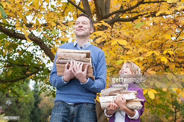 Germany, Leipzig, Father and son collecting firewood