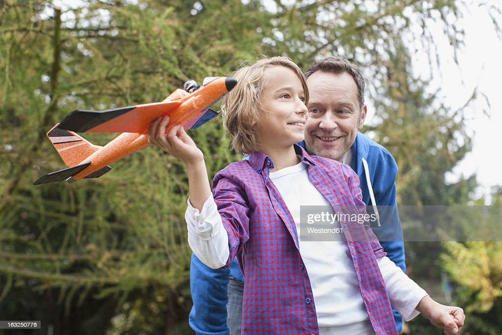 Germany, Leipzig, Father and son having fun, smiling : Stock Photo