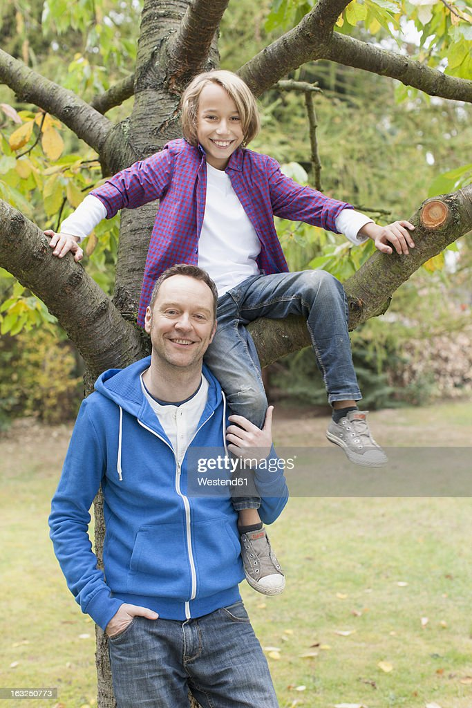Germany, Leipzig, Father and son having fun, smiling, portrait : Stock Photo