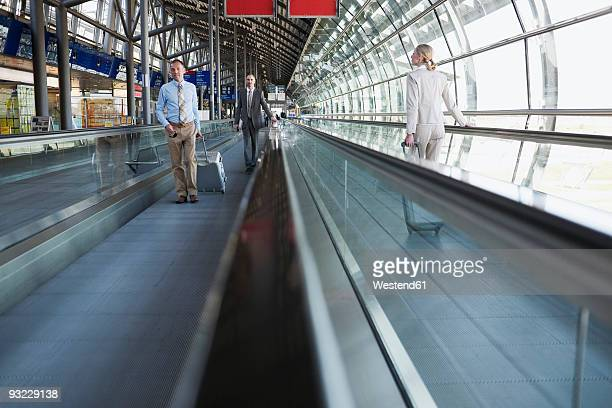Germany, Leipzig-Halle, Business people on travelator at airport