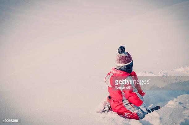 Germany, little boy having fun in snow
