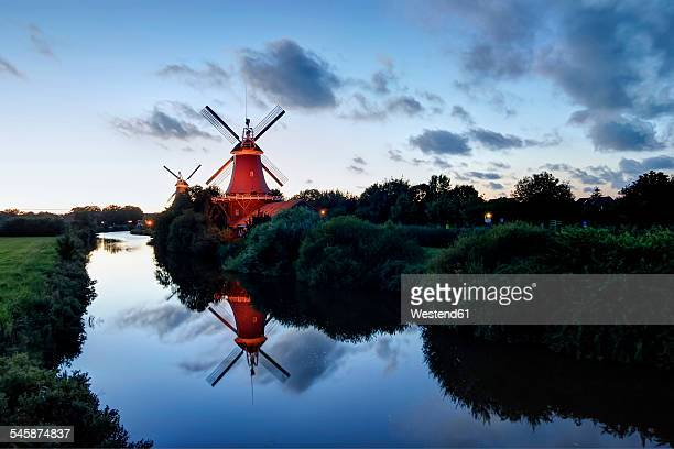 Germany, Lower Saxony, Greetsiel, traditional windmills in the evening light