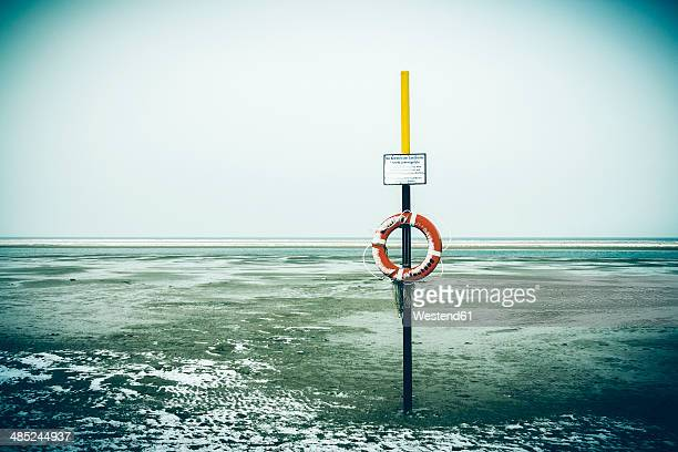 Germany, Lower Saxony, lifesaver at the beach of Langeoog