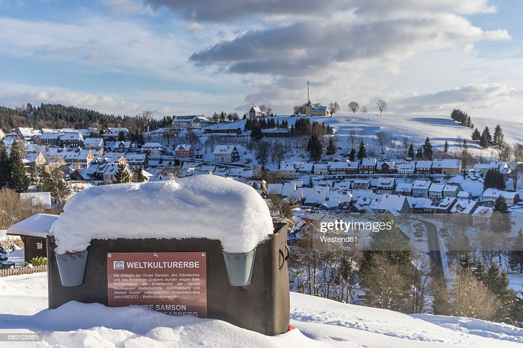 Germany, Lower Saxony, townscape of Sankt Andreasberg and tipper wagon of Samson Pit in winter